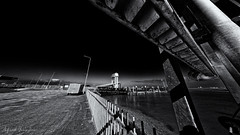 Through A Fence Perspective (Alfred Grupstra) Tags: harbour fence dock blackandwhite bridgemanmadestructure architecture sea builtstructure nopeople urbanscene road outdoors sky night street transportation river famousplace dark city cityscape dusk