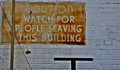 Caution (Gerry Dincher) Tags: caution arrow orangeburg orangeburgcounty southcarolina alley brick rust sign watchforpeopleleavingthisbuilding bricks russellstreet downtownorangeburg downtown gerrydincher