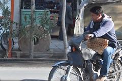 iran dec 18 (76) (gerboam) Tags: iran islamic republic december 2018 man hoodie blue jeans moto millstone plants trees shutter flatbread bread food