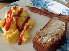 Breakfast. (dccradio) Tags: lumberton nc northcarolina robesoncounty indoor indoors inside food eat breakfast meal apple ipad mini2 january winter monday mondaymorning morning goodmorning eggs ketchup catsup scrambledeggs bacon amishfriendshipbread buttered butter quickbread corelle plate