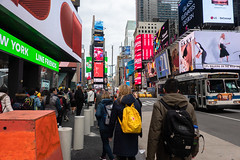Yellow Stands Out (Jocey K) Tags: sonydscrx100m6 triptocanadaandnewyork architecture buildings street people words signs bus sky clouds timessq billboards