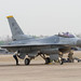 Perform pre-flight checks on a USAF F-16 Fighting Falcon before taxiing prior to kick-off of Exercise Cobra Gold