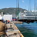 Landing Craft, Utility 1631 is lifted out of the water in preparation for docking at India Pier at Sasebo