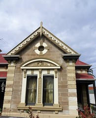 Woodville Adelaide.  Beautiful gable ended villa house built in the 1880s in sandstone. Decorative barge boards and air vent in the stonework. (denisbin) Tags: woodville adelaide villa stone queenanne artdeco shop cornershop gable bargeboards sandstone