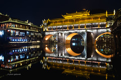 Rainbow Bridge (pietkagab) Tags: hongqiao rainbowbridge river tuo night water still reflection reflections lit illuminated dark covered gate hunan china chinese asia asian architecture building buildings waterfront mirror pietkagab photography pentax piotrgaborek pentaxk5ii travel trip tourism sightseeing adventure