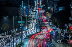 over broadway at polk street (pbo31) Tags: sanfrancisco california night dark christmaseve december 2018 color nikon d810 boury pbo31 city urban lightstream motion traffic roadway black rain wet over broadway russianhill hydestreet infinity red reflection