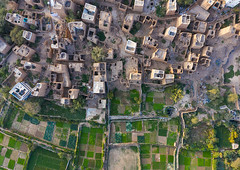 Aerial view of an old village with traditional mud houses, Asir province, Dhahran Al Janub, Saudi Arabia (Eric Lafforgue) Tags: adobe aerialview agriculture arabia arabicstyle architectural architecture aseer aseerprovince asir assir brick building buildingexterior builtstructure colorimage cultivatedland dahranaljanub day drone farm field habitation horizontal house ksa middleeast midmakh mudbrick nopeople oldbuilding oldhouse outdoors photography qahtan saudiarabia saudi181967 tourism travel traveldestinations village dhahranaljanub asirprovince sa