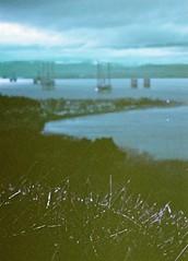 Oil Rig Graveyard, Cromarty Firth, March 2016 (Mano Green) Tags: oil rig graveyard sea water sky cloud coast cromarty firth black isle scotland uk march 2016 winter lomochrome purple 35mm film canon eos 300 40mm lens depth field