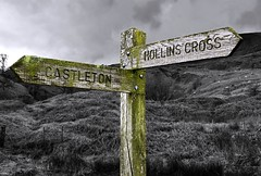 Castleton or Hollins Cross ? (rustyruth1959) Tags: nikon nikond5600 nikon1855mm uk england derbyshire castleton hollinscross post signpost sign fingerpost selectivecolour outdoor directions hillside bw walk countryside writing moss wood grass sheep animals grazing darkpeak peakdistrict tree sky clouds texture