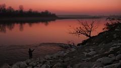 The Moment Of Eternity (AIeksandra) Tags: sunset river landscape winter february fishing fisherman cremona lombardia lumixgh4 panasonicgh4 lumix1235mm