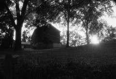 In Kelso (Blia100) Tags: barn black white grotto grove bokeh light leaves sun sunset autumn fall film grain believeinfilm polypan canon rebel eos ef 2890mm