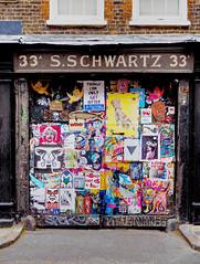 Gates to S. Schwartz's dairy yard (HVHY4C3E7S3Y3Q3HRVKYFJJLOK) Tags: graffiti art flyposting bricklane london