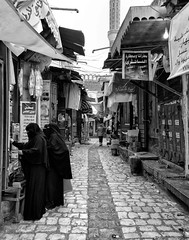 Sana'a Street (Rod Waddington) Tags: middle east yemen yemeni sanaa streetphotography street stone culture cultural city urban blackandwhite mono monochrome women traditional tribe tribal shopping shops outdoor