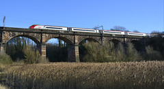 Dutton Viaduct (elr37418) Tags: virgin red sliver viaduct bridge railway river weaver cheshire england uk dutton liverpool london blue sky pendolino trains