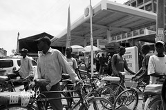 The Urban Transport Collection (JeepChic) Tags: blackandwhite streetphotography africa kenya bikes boarderboarder transportation men citylife urbanlife taxies biketaxies