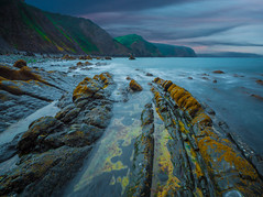 Heading For The Hills (Wizard CG) Tags: rocks sea water rock formation tide sky landscape outdoor north devon blackchurch ocean sunset nd longexposure beach summer mouthmill cove epl7 seascape seaview grass mountain river bay