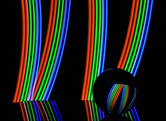 RGB Stripes (Karen_Chappell) Tags: led lightpainting ball orb sphere glass round circle refraction lights black rgb red green blue stilllife reflection reflections lines curve shape