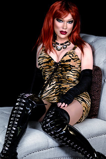Redhead in tigress dress and thigh high boots