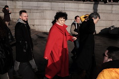 Lady in Red (Gary Kinsman) Tags: fujix100t fujifilmx100t london 2019 chinesenewyear wc2 candid streetphotography streetlife chinesenewyearcelebrations chinesenewyear2019 yearoftherat crowd crowded trafalgarsquare people person fujifilmxpro1efx20 efx20 flash ladyinred