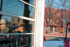 diners-at-band-box (kaumpphoto) Tags: mamiya nc1000s color kodak portra 800 street urban city dine eat building neighborhood reflection window orange white blue minneapolis road couple