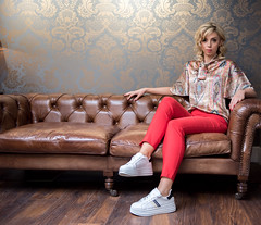 Leah (shaymurphy) Tags: smp7374 model fashion photo photography runners sneakers blond blonde woman leather couch red trousers nikon d750 nikkor 2470 leah cotton threadz clothing carol sheridan interiors lara belle makeup hair yvonne curtis pretty beautiful irish gorgeous beauty interior inside indoors