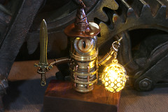 Robot wizard with glowing lantern (Catherinette Rings Steampunk) Tags: fantasy adoptables dungeons dnd sculpture modron handmade etsy metal art artisan wirewrapped figurine creatures weird oneeyed cyclopean brass copper canadian glowing cute