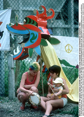 7.52/45 (hoffman) Tags: baby female fence greenham greenhamcommon lady missile peacecamp protest tambourine usaf vertical woman women young youth peace davidhoffman wwwhoffmanphotoscom london uk