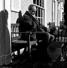 Not Being old. (Neil. Moralee) Tags: neilmoralee neilmoraleehoniton old man elderly sitting sinshine shadow mature thinking street candid honiton devon uk neil moralee nikon d7200 black white bw bandw blackandwhite mono monochrome contrast spring bright hip bench