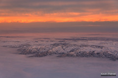 Orange Sunrise Inversion (kevin-palmer) Tags: flight airplane windowseat sheridan wyoming winter march snow early morning sunrise dawn nikond750 tamron2470mmf28 color colorful gold orange pink hills clouds fog foggy inversion sky