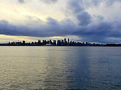 The Threatening Sky (walneylad) Tags: vancouver britishcolumbia canada downtown city urban skyline cityscape portofvancouver burrardinlet sea ocean pacificocean shoreline waterfront cbd buildings towers canadaplace sky water sunset glow clouds cloudy blue grey sun light dark threatening december winter view nature scenery