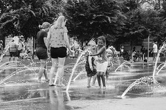 Kids Playing in the Water (adrianmichaelphotography) Tags: ricoh ricohgr ricohgrii streetphotography streetphotographer denverphotographer denver blackandwhite blackandwhitephotography kids water summer laughter smiling children