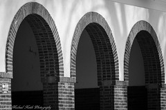 Three Arches (mayor_79) Tags: arch arches building architecture brick symmetry three black white blackandwhite geneva il islandpark facade art abstract park pavilion concrete wall entry door curve line tone texture shadow depth old geometry shapes light daylight