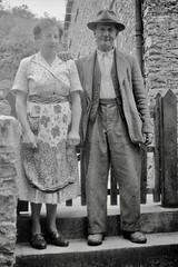 Michael Palin's father? (vintage ladies) Tags: vintage blackandwhite photograph photo man male couple woman lady hat step apron