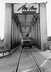 Danube bridge (Drehscheibe) Tags: brücke tracks classicblackwhite nikonf2 blackwhite 35mm film hp5plus explore ilford ilfordmicrophendeveloper truck lkw gleise