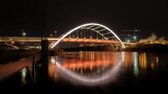 Water Under the Bridge (TnOlyShooter) Tags: koreanveteransbridge nashville tennessee cumberlandriver night reflections water em1markii 918mm olympus mirrorless