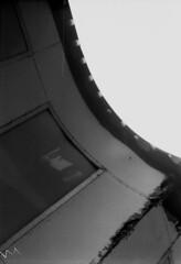Roof Line with Lights (Pics from the Bird Cage) Tags: argentique leica leicaiiic hp5 film ilfordhp5plus400 35mm alberta ishootfilm leica3c ilfordhp5plus ilfosol3 edmonton edmontonalberta blackandwhite blackwhite summitar summitar5cmf20 barnack whyteavenue analog analogue bulkfilm classiccamera camera monochrome iso iso400 strathcona streetphotography outdoors