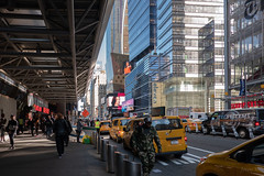 A Line of Yellow Cabs (Jocey K) Tags: sonydscrx100m6 triptocanadaandnewyork architecture buildings streets people signs sky highrises cabs newyorkcity