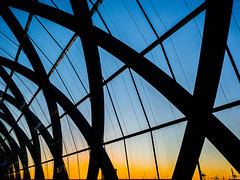 Crisscrossing the sunset (Ulrich Neitzel) Tags: architecture architektur bahnhof dach dämmerung dusk elbbrücken hafencity hamburg himmel lines linien mzuiko1240mm metro olympusem1 roof sky sonnenuntergang station sunset ubahn