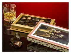 Whiskey and Chocolate. It a hard life. (johnhjic) Tags: broncolor whiskey red reflection reflections reflecting flash gold hasselblad x1d johnhjic studio siros bettys chocolate harrogate yorkshire