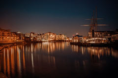 The golden hour........ (Dafydd Penguin) Tags: slow shutter speed long exposure tripod night shots nawks nighthawks after dark city urban town centre buildings light stars reflections gold water sea harbour harbor port dock quay harbourside waterside quayside ss great britain passenger ship vessel historic largest world iron isambard kinkdom brunel bristol floating leica m10 summicron f2 35mm asph