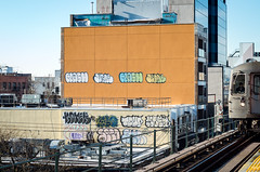 Bombed Orange Wall (Edgar.Omar) Tags: nyc graffiti wall mta tracks pentax k50 tag bombed sigma macro 5028 sigmamacro5028 colors orange subway conductor stranger astoria commute commuter art moment ditmars nw train