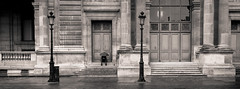 Waiting For A Sign (LoKee Photo) Tags: lokee street urban paris louvre step rain umbrella lonely man silhouette black white monochrome fujifilm gfx 50r panoramic