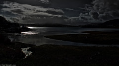 Moon Loch (Neil. Moralee) Tags: neilmoralee skye2019 lake dark water moon sun clouds landscape seascape loch scotland skye portree neil moralee olympus omd em5 colour subdued unsaturated low light winter