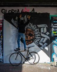 Unknown Artist (Sam Codrington) Tags: spitalfieldfarm streetartist streetart outdoor london artist mural balancing people bicycle graffiti shadow bricklane painting towerhamlets england unitedkingdom gb street man style urban