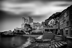 Catalan Bay (gibwheels) Tags: beach catalan bay mediterranean sand clouds movement hotel village black white monochrome rock gibraltar sea shore nikon home