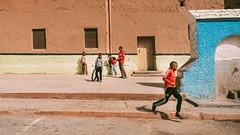 Boys Will be Boys (Tom Levold (www.levold.de/photosphere)) Tags: fuji marokko morocco x100f zagora street play kinder children jungen kids spiel football ball candid boys fusball