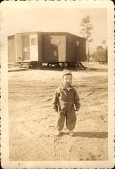 Young Child in Long Sleeved Outfit (Familypapers) Tags: portrait blackandwhitephoto children babypictures loblollypine pinustaedus deepsouth americansouth trailerpark young child winter overalls robertsdale alabama usa