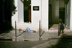 dreams (gguillaumee) Tags: film analog grain colorfilm fujisuperia paris streetphotography sun light candid store homeless sleeping trotinette leicam7 leica contrast