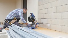 handsome young man carpenter using a circular saw while installing wood floor terrace outdoor (SawAdvisor) Tags: circular saw woodworking carpenter cutting circularsaw