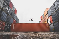 business-commerce-container-379964 (toptenalternatives) Tags: business commerce container export freedom industry jumping jumpshot low angle shot man outdoors person photoshoot pose posing puddle rocks shipment steel warehouse wet